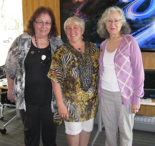 """Naamat Canada Edmonton president Darlene Bushewsky formally welcomes and """"pins"""" new members Helen Conroy (left) and Marcia Czitron (right) to the Avival Chapter at the 90th Anniversary Membership Celebration on June 14."""