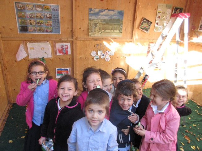 Menorah Academy Grade 1 students enjoyed visiting a number of Sukkahs over the holiday in a Sukkah Hop.