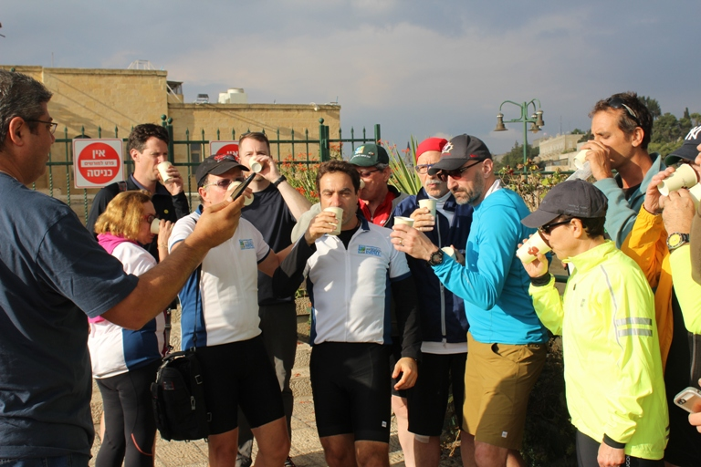 The JNF Bike Mission participants enjoy a le'Chaim after an exciting day of touring.