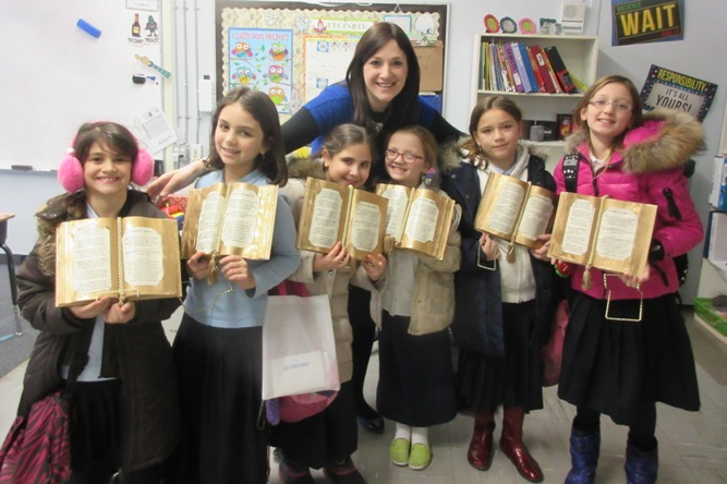 Menorah students make beautiful golden open books for Chanukah.