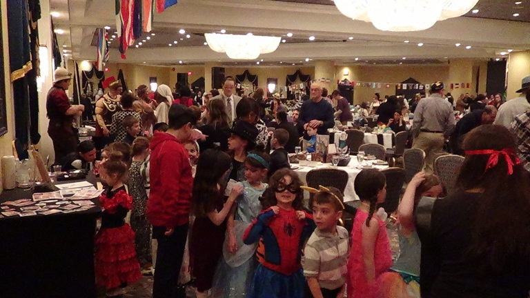 The kids paraded around the hall so everyone could see their Purim costumes.