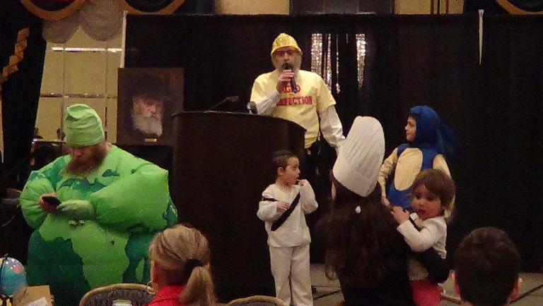 Rabbi Ari Drelich welcomed the crowd and thanked everyone for coming to Chabad Edmonton's International Purim