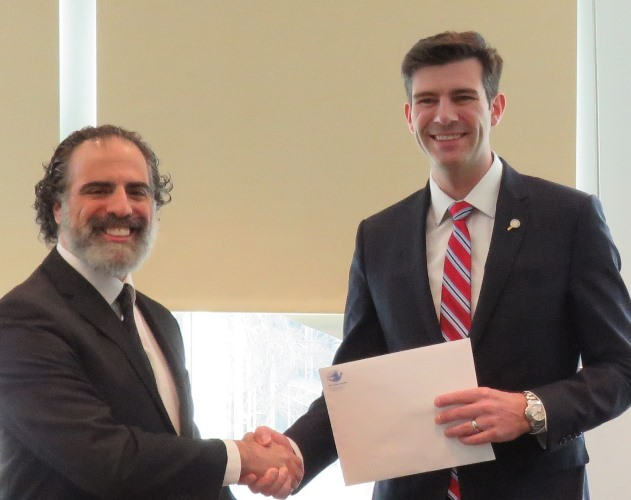After the formal documents were signed for the selling of the chametz, Rabbi Rose and Mayor Iveson shook hands on the deal. Photo by Daniel Moser